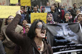 FILE - An Egyptian activist shouts anti-military Supreme Council slogans during a demonstration in front of Cairo's high court, March 16, 2012. An independent Egyptian daily says the state's top women's advocacy group has filed a complaint with the c