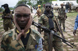Seleka fighters stand in their base before a mission in the town of Lioto, Central African Republic, June 9, 2014.