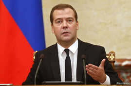 Russia's Prime Minister Dmitry Medvedev leads a government meeting in Moscow, Aug. 7, 2014.