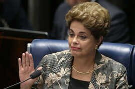 Brazil Political Crisis: Suspended Brazilian President Dilma Rousseff waves goodbye after her impeachment trial at the Federal Senate in Brasilia, Brazil, Monday, Aug. 29, 2016.