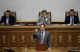 Jose Guerra (C), deputy of the Venezuelan coalition of opposition parties (MUD) and president of the economic special commission, gives a speech during a session of the National Assembly in Caracas, Jan. 22, 2016.