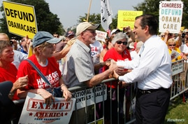 U.S. Senator Ted Cruz (R-TX) (R) greets attendees as he arrives to speak at the Tea Party Patriots 'Exempt America from Obamacare' rally on the west lawn of the U.S. Capitol in Washington, Sept. 10, 2013.