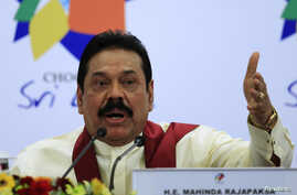 Sri Lankan President Mahinda Rajapaksa gestures as he speaks during a news conference at the Commonwealth Heads of Government Meeting (CHOGM) in Colombo, Nov. 17, 2013.