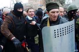 Pro-Russia militiamen detain the head of the regional police after storming the regional police building in the eastern Ukrainian city of Horlivka (Gorlovka), near Donetsk, on April 14, 2014.
