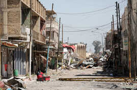 Debris is seen on a street controlled by Iraqi forces fighting the Islamic State in Mosul, Iraq, April 6, 2017.