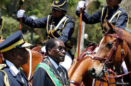 Zimbabwe's President Robert Mugabe arrives for the opening of Parliament in Harare, Zimbabwe, Oct. 6, 2016.