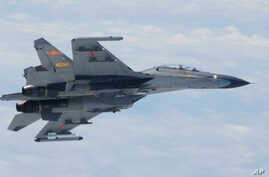In this undated photo released by Japan Ministry of Defense, Chinese SU-27 fighter plane is shown. China and Japan are blaming each other for a close encounter between military jets over the East China Sea.