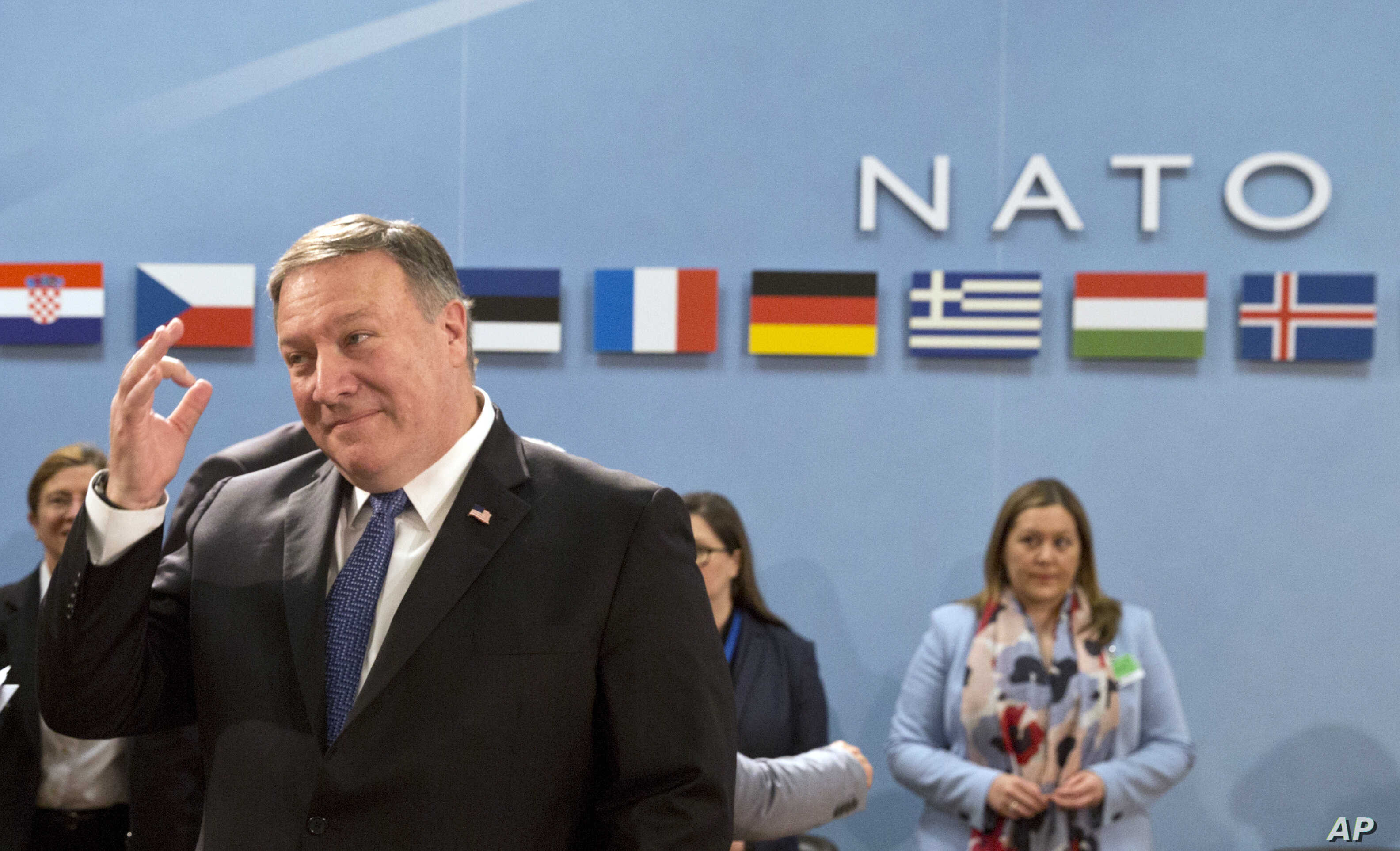 U.S. Secretary of State Mike Pompeo, left, waits for the start of the North Atlantic Council at NATO headquarters in Brussels, April 27, 2018.