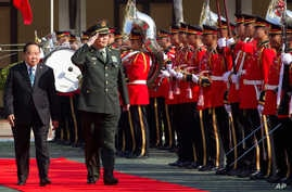 FILE - Thailand's Deputy Prime Minister and Defense Minister Prawit Wongsuwan (L) and China's State Councilor and Defense Minister Chang Wanquan review an honor guard at the Ministry of Defense in Bangkok, Feb. 6, 2015. Prawit and Chang held talks th