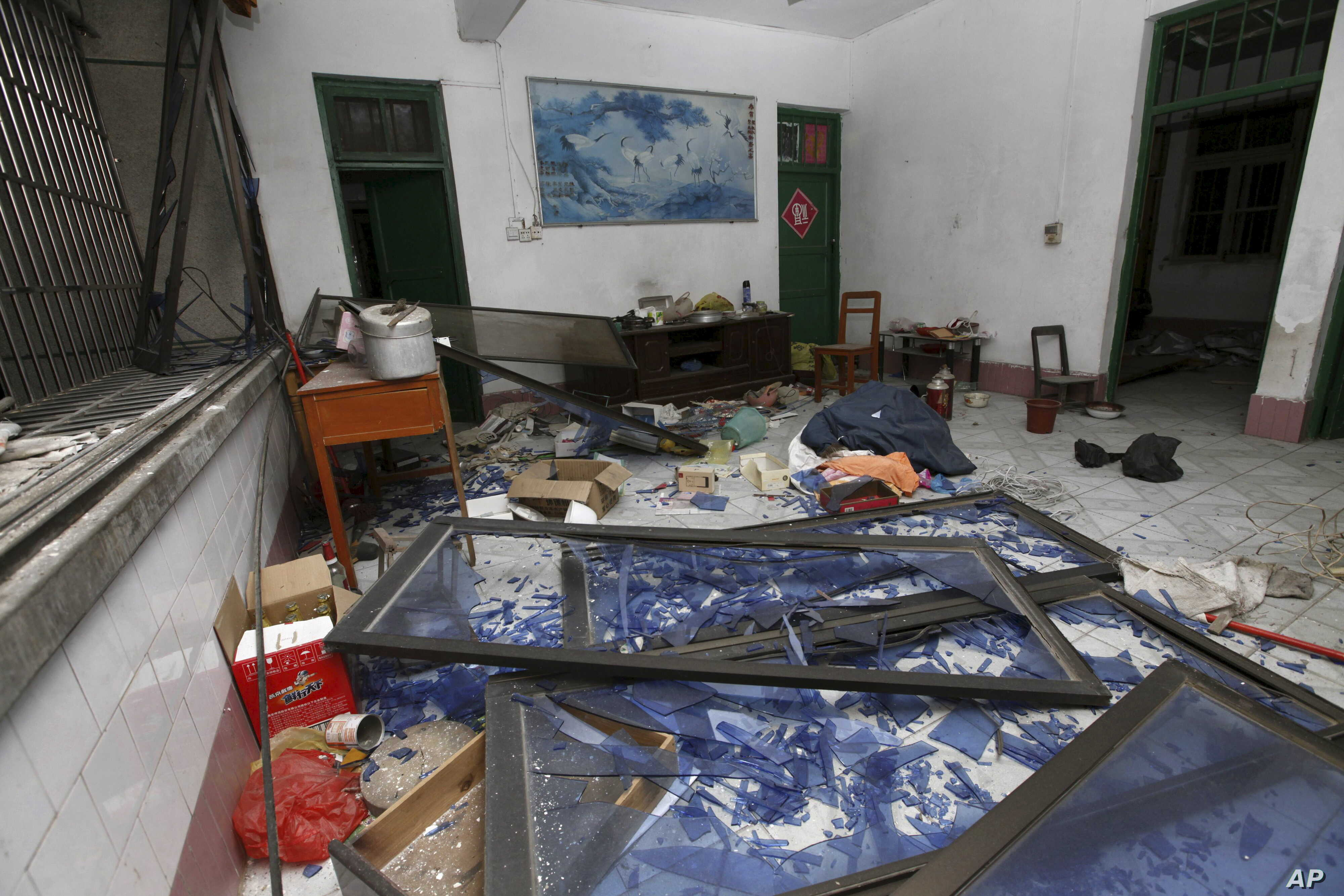 A damaged room in a residential building is seen after several locations were targeted with parcel bombs in the southwestern city of Liuzhou, Guangxi province, Sept. 30, 2015.
