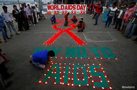 Children light candles during an HIV/AIDS awareness campaign on the occasion of World AIDS Day in Kolkata, India, December 1, 2017.