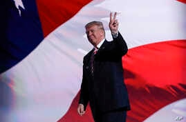 FILE - Republican Presidential Candidate Donald Trump stands on stage during the third day session of the Republican National Convention in Cleveland.