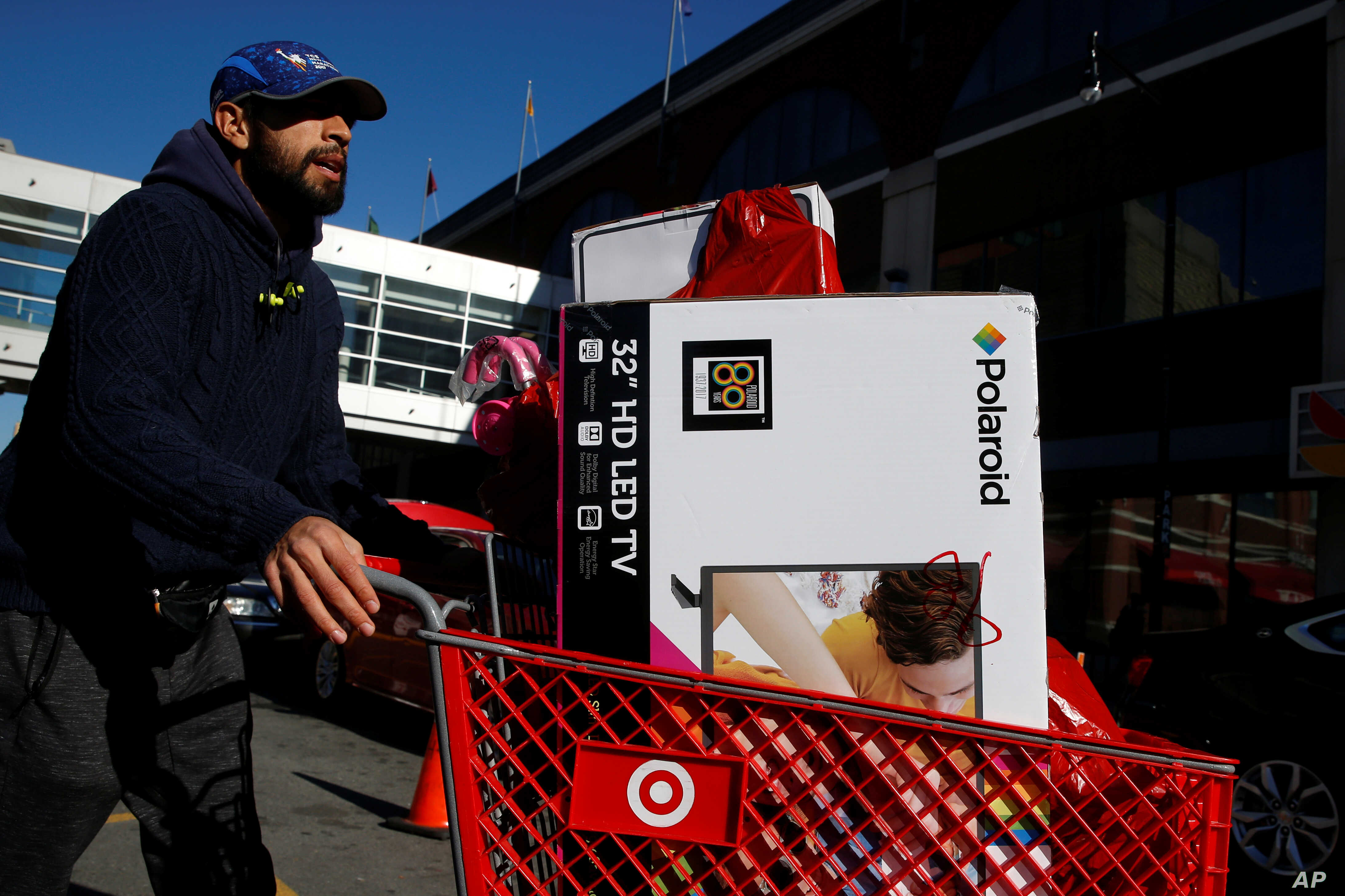 A man pushes a cart full of goods after shopping at a Target store during Black Friday in Brooklyn, N.Y., Nov. 24, 2017.