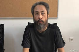 Japanese journalist Jumpei Yasuda is pictured at the local police headquarters in Hatay, Turkey, Oct. 24, 2018. (Hatay Governorship/Turkish Police/Handout via Reuters)