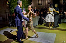 President Barack Obama and first lady Michelle Obama do the tango with dancers during the State Dinner at the Centro Cultural Kirchner, March 23, 2016, in Buenos Aires, Argentina.