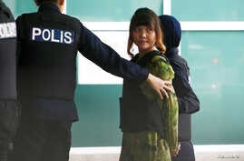 Vietnamese Doan Thi Huong who is on trial for the killing of Kim Jong Nam, the estranged half-brother of North Korea's leader, is escorted as she arrives at the Department of Chemistry in Petaling Jaya, near Kuala Lumpur, Malaysia October 9, 2017.