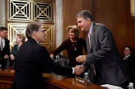Energy Secretary Rick Perry, left, speaks with Sen. Joe Manchin, D-W.Va., right, ranking member of the Senate Energy and Natural Resources Committee, and committee chairwoman, Sen. Lisa Murkowski, R-Alaska, before testifying  April 2, 2019, on Capito