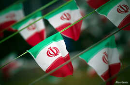 FILE - Iran's national flags fly in a square in Tehran, Feb. 10, 2012, a day before the anniversary of the Islamic Revolution.