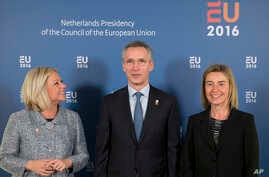 NATO Secretary General Jens Stoltenberg, center, is flanked by EU High Representative Federica Mogherini, right, and Netherlands' Defense Minister Jeanine Hennis-Plasschaert in Amsterdam, Netherlands, Feb. 5, 2016.