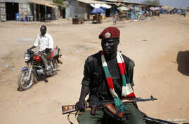 An SPLA soldier drives in a vehicle in Juba December 21, 2013. African mediators sought on Saturday to meet rivals to South Sudan's president in a bid to end fighting that threatens to drag the world's newest country into an ethnic civil war. REUTERS