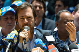 FILE - Chacao's Mayor Ramon Muchacho speaks next to other opposition mayor during a press conference at the Bolivar square in the Chacao neighborhood in Caracas, on May 25, 2017.