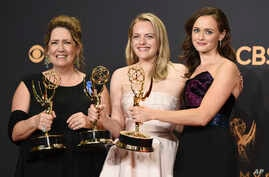 "Ann Dowd, from left, winner of outstanding supporting actress in a drama series, Elisabeth Moss, winner of outstanding lead actress in a drama series, and Alexis Bledel, winner of outstanding guest actress in a drama for ""The Handmaid's Tale"" pose at"