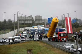 Truckers block the highway near Calais, northern France, Sept. 5, 2016.