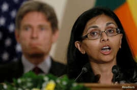 Nisha Biswal, U.S. Assistant Secretary of State for South and Central Asian Affairs, speaks next to Tom Malinowski, Assistant Secretary of State, after meeting Sri Lanka's Foreign Minister Mangala Samaraweera (not pictured) in Colombo, Sri Lanka, Jul