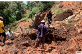 A family in Chimanimani digs, March 22, 2019, without protective clothing, for their missing 17-year-old nephew after Cyclone Idai hit the area. The body was found late Friday a week after he was trapped in his bedroom while asleep.