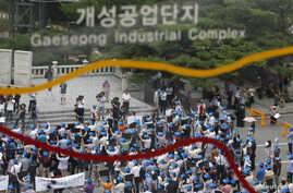 FILE- Protesters comprising of South Korean employers and employees working at factories in the Kaesong Industrial Complex (KIC) inside North Korean chant slogans during a rally at the Imjingak pavilion.