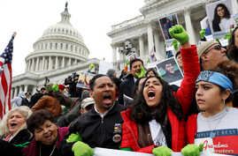 Protesters urge Congress to pass a bill that will allow undocumented immigrants who were brought to America as children to permanently stay in the country, on Senate steps in Washington, Dec. 6, 2017.