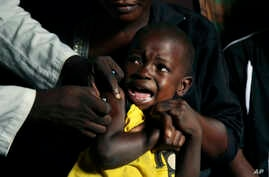 A boy reacts as he receives a yellow fever vaccine injection in the Kisenso district of Kinshasa, Congo, on July 21, 2016.