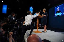 Comedian Simon Brodkin, also known as Lee Nelson, interrupts the Conservative Party Leader and Prime Minister, Theresa May, during her speech at the Conservative Party Conference at Manchester Central, in Manchester, England, Oct. 4, 2017.