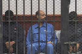 Saif al-Islam Gadhafi in the accused cell as he stands trial for illegally trying communicating with the outside world in June of 2012, Zintan, Libya, May 2, 2013.