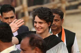 FILE - Priyanka Gandhi Vadra, daughter of Congress party President Sonia Gandhi, waves to party supporters during an election campaign rally in Rae Barelli in the northern Indian state of Uttar Pradesh, India, Feb. 16, 2017.
