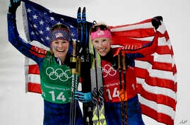 United States' Jessica Diggins, left, and Kikkan Randall celebrate after winning the gold medal in the women's team sprint freestyle cross-country skiing final at the 2018 Winter Olympics in Pyeongchang, South Korea, Wednesday, Feb. 21, 2018.