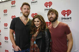 Lady Antebellum's Charles Kelley, Hillary Scott and Dave Haywood, from left, arrive at the iHeartRadio Country Festival in Austin, Texas, March 29, 2014.