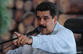 Venezuela's President Nicolas Maduro speaks during a visit to an industrial sawmill in Chaguaramas, Venezuela, Aug. 18, 2016. (Miraflores Palace/Handout)