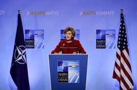 FILE - FILE - U.S. Ambassador to NATO Kay Bailey Hutchison speaks during a media conference at NATO headquarters in Brussels, July 10, 2018.