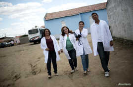 FILE - Cuban doctor Elza Vega Rodriguez (2nd L) walks with her Brazilian team of assistants near the health center where they work, in Piaus, north-eastern Brazil, Nov. 20, 2013.