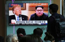 People watch a TV screen showing file footage of U.S. President Donald Trump, left, and North Korean leader Kim Jong Un during a news program at the Seoul Railway Station, in Seoul, South Korea, April 18, 2018.