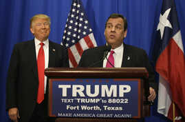 Republican presidential candidate Donald Trump smiles as he stands with New Jersey Gov. Chris Christie before a rally in Fort Worth, Texas, Feb. 26, 2016.