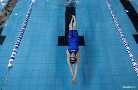 Palestinian swimmer Mary Al-Atrash, 22, who will represent Palestine at the 2016 Rio Olympics, trains in a swimming pool in Beit Sahour, near the West Bank town of Bethlehem, June 27, 2016.