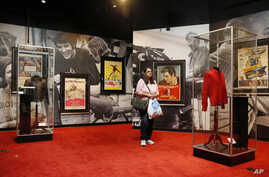 "A visitor scans items on display at ""Graceland Presents Elvis: The Exhibition"" at the Westgate Las Vegas Resort and Casino, April 23, 2015."