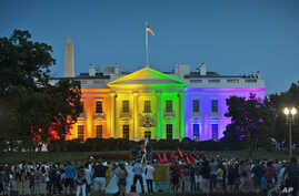 FILE - people gather in Lafayette Park to see the White House illuminated with rainbow colors in commemoration of the Supreme Court's ruling to legalize same-sex marriage in Washington.