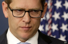White House press secretary Jay Carney pauses as he answers questions during his daily news briefing at the White House in Washington, May, 14, 2013.