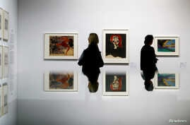 "Two women look at works of art during a media preview at the exhibition ""Gurlitt: Status Report Degenerate Art confiscated and sold"" at the Kunstmuseum in Bern, Switzerland, Nov. 1, 2017."