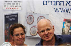 The parents of captured Israeli soldier Gilad Shalit are seen at a protest tent outside the residence of Israel's PM Netanyahu in Jerusalem 12/10/2011