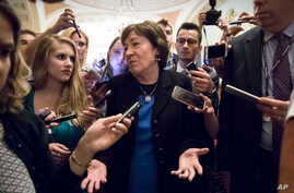 Sen. Susan Collins, R-Maine, is surrounded by reporters on Capitol Hill in Washington, July 13, 2017, after a revised version of the Republican health care bill was announced by Senate Majority Leader Mitch McConnell of Kentucky.