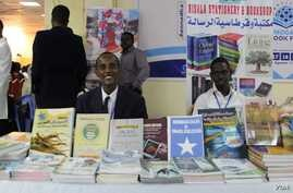 Participants are seen behind a display at the Mogadishu Book Fair in Mogadishu, Somalia. (Courtesy - Mogadishu Book Fair)